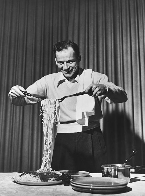 Frank Sinatra clowning around with spaghetti for a commercial on The Frank Sinatra Show, c. 1952