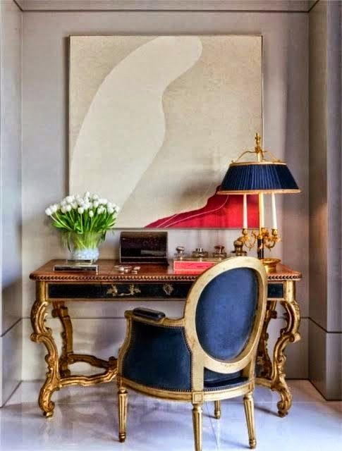 beautiful living room with gold and modern art vignette