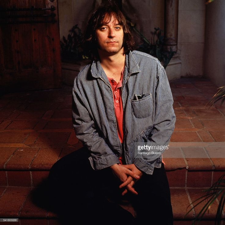 American guitarist Peter Buck from rock band R.E.M (composed of lead vocalist Michael Stipe, bass guitarist Mike Mills and drummer and drummer/percussionist Bill Berry).