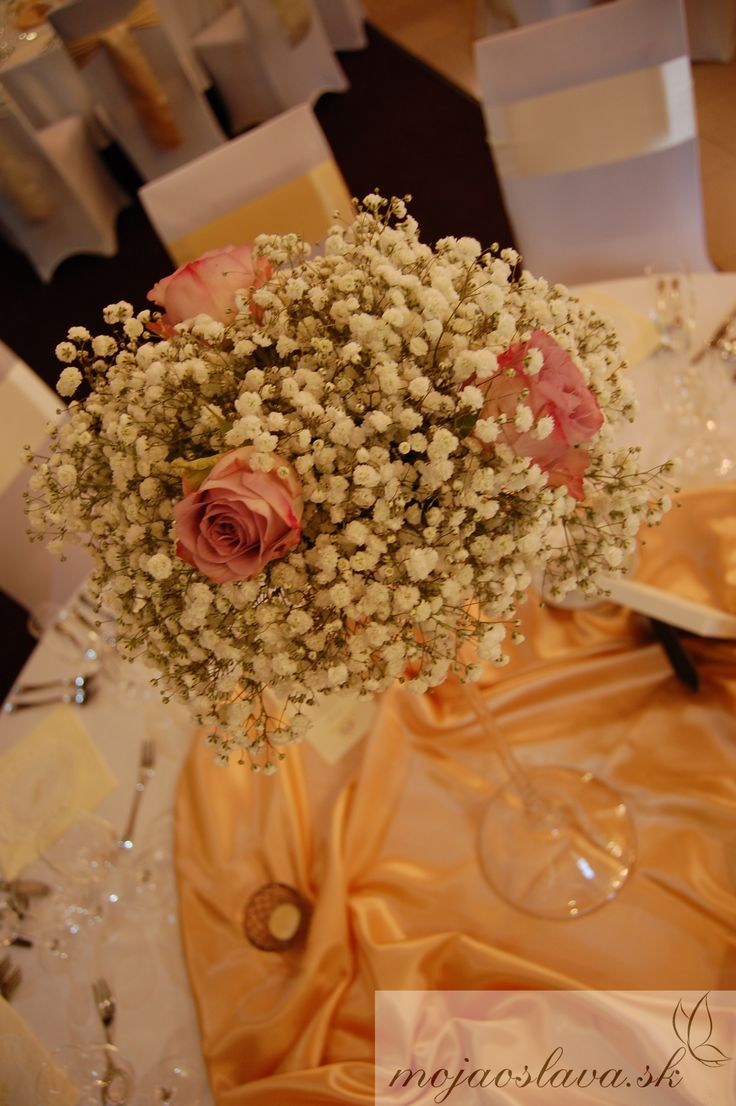 white gypsophila with pastel purple roses