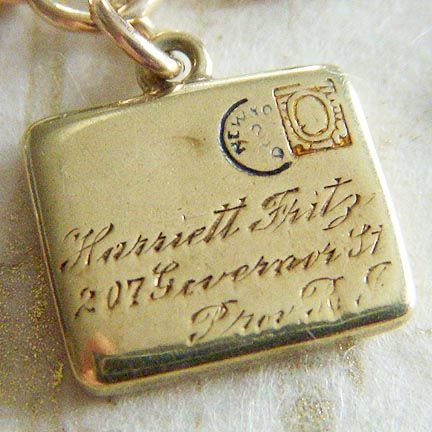 Vintage hand-engraved and enamel letter charm