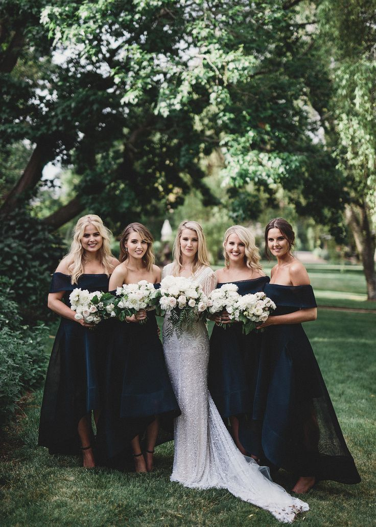 An elegant Hopewood House wedding captured by Alma Photography. The bride wears a long sleeve gown by Inbal Dror and the bridesmaids wear navy blue.