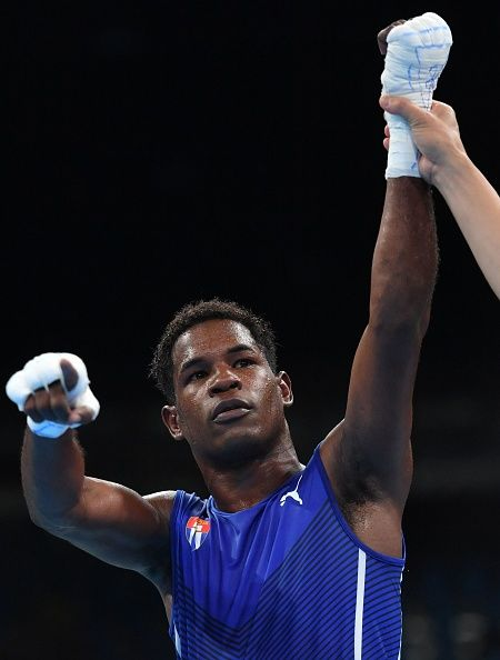 Cuba's Yasnier Toledo celebrates wining against Great Britain's Pat Mccormack…