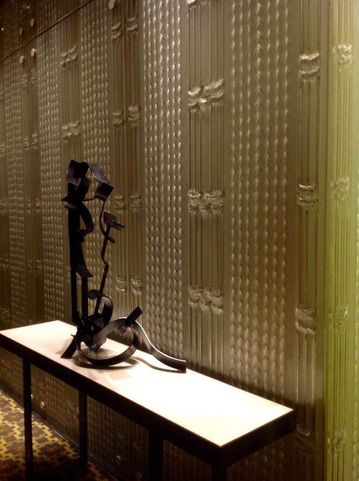 The use of a textured glass wall results in a luxe feel.