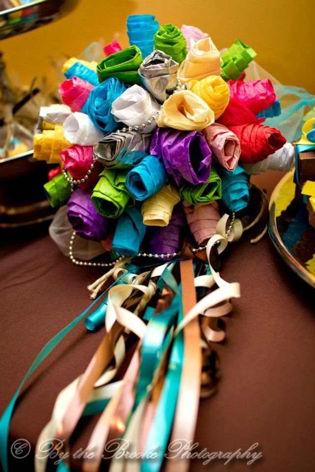 A twist on the usual paper plate rehearsal bouquet! Made from the tissue paper and ribbons from the bridal shower gifts!