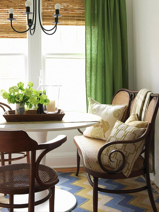 Kelly green curtains and white patterned pillows set a sophisticated tone in this space.