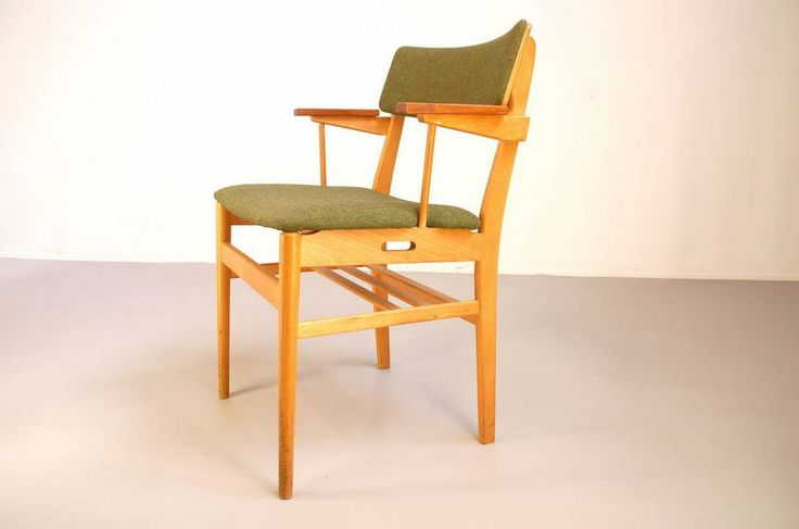 If you like furniture with a story then this is something for you. These chairs were designed by Vestervig Eriksen for a Danish church. The little shelve like thing behind the back legs is a silent witness of this. The frame is in oak with teak armrests. Seat and back are in green fabric.