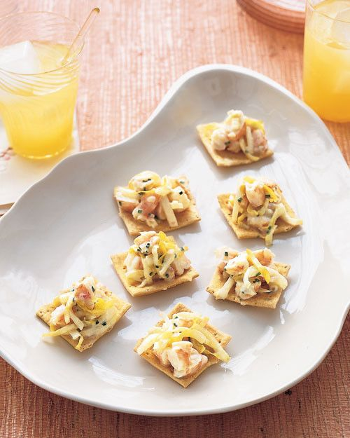 Sweet shrimp are poached in white wine and combined with a lemon-shallot vinaigrette. The refreshing shrimp salad appetizer is mixed with thinly sliced endive and served with crackers.