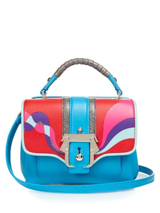 Paula Cademartori's aqua-blue calf-leather Dun Dun shoulder bag is inspired by the vivid hues of the ocean. It has a compact, boxy shape that showcases a multicoloured leather front with silver-tone hardware, and is finished with grey glitter accents. Play up the tones with highly saturated ready-to-wear. | Available at MATCHESFASHION.COM