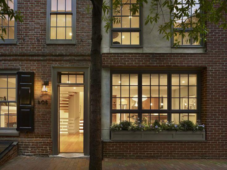 Box trim exterior contemporary with brick house dark windows
