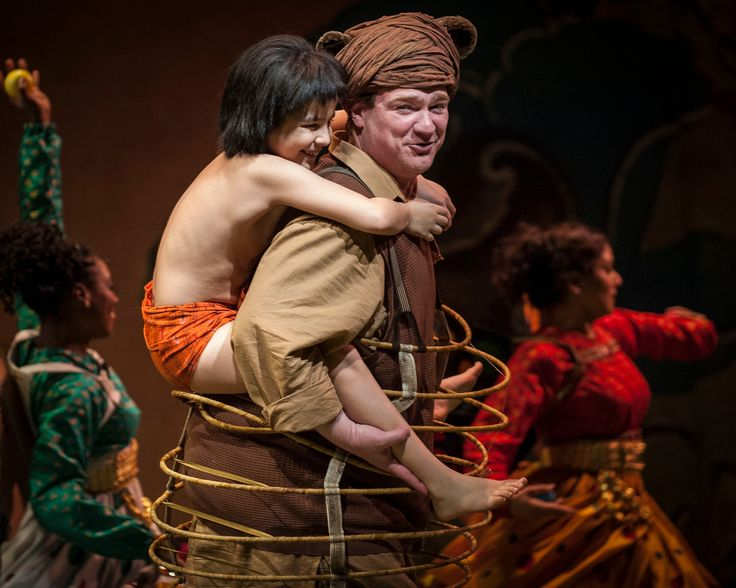 """Mary Zimmerman's new musical adaptation of The Jungle Book,the tale of the """"man-cub"""" Mowgli who is adopted and raised by wolves in an Indian jungle, now running at Goodman Theatre, is a solid production punctuated by some high notes and more than just the 'Bare Necessities."""" The hope/hype, for the world premiere production is that... <a href=""""http://www.chicagonow.com/show-me-chicago/2013/07/mary-zimmermans-the-jungle-book-at-the-goodman-theatre-more-than-the-bare-ne..."""