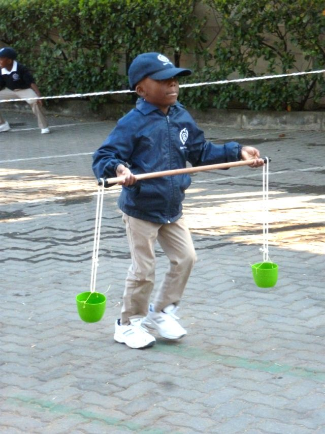 Bucket and water obstacle course - great for improving body awareness.