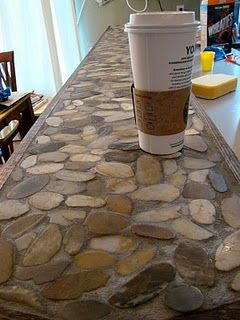 River Rock Countertops Gonna use this idea for our circle coffee table. Instead of using glass again
