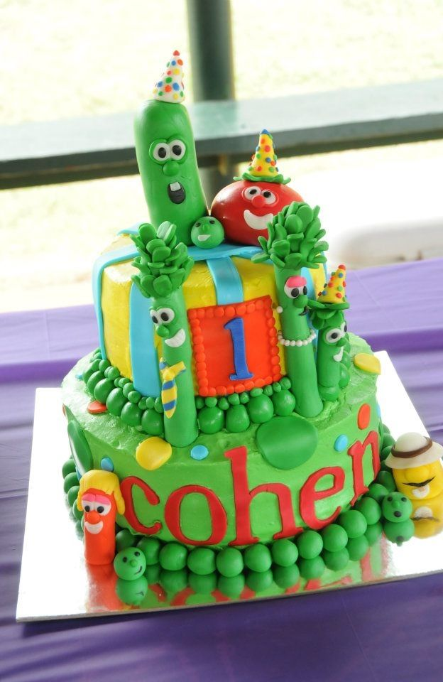 Veggie Tales Cake - This cake has butter cream frosting and fondant decorations. The characters are fondant/gum paste.