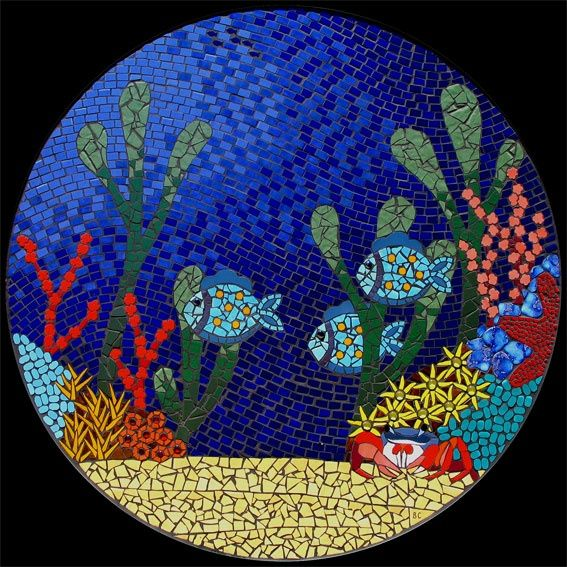 Underwater ocean scene featuring colourful corals, fish, a crab and sea grasses Down under mosaic table in ceramic tiles by Brett Campbell Mosaics