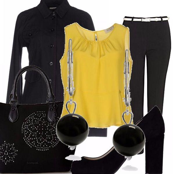 Come una foglia che cade, il top leggerissimo in seta gialla si abbina al rigoroso nero dei pantaloni di taglio classico , da indossare con la giacca , le decolettè in camoscio e la borsa con motivi ricamati. Completano l'outfit gli orecchini con grandi charmes nere.