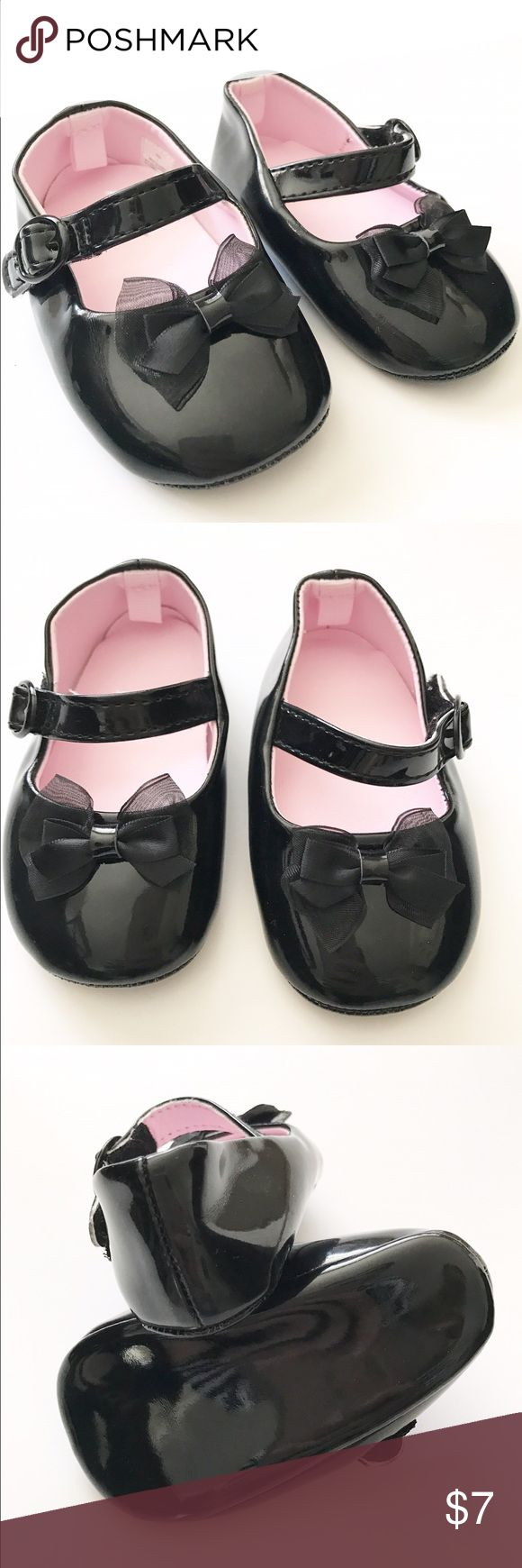 Black patent leather maryjane shoes Great condition. Bows on the toes and side velcro closure. Shoes