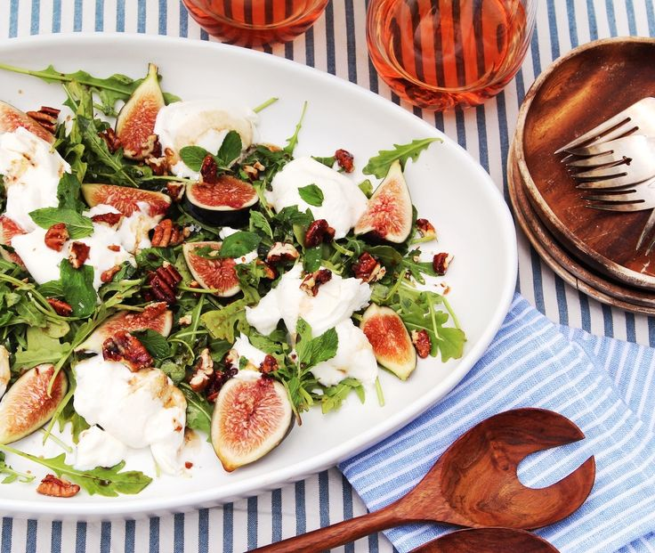 A perfect summer salad topped with fig & burrata.