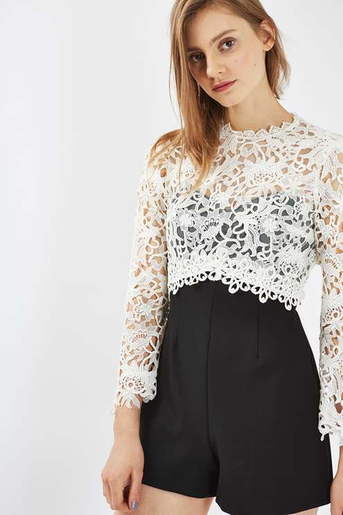 Luxe lace is always an appropriate choice for a dressed-up look. This playsuit comes with stunning white lace detail to the top, contrasting perfectly with the black flippy-style shorts. Finished with an open back to expose just the right amount of skin. #Topshop