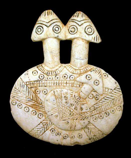 "Early Bronze Age Stone Double-Headed Disc-Shaped Figurine and Child - PF.0310 Origin: Central/Western Anatolia Circa: 3000 BC to 2500 BC Dimensions: 6"" (15.2cm) high x 5"" (12.7cm) wide Catalogue: V1 Collection: Biblical Medium: Stone"