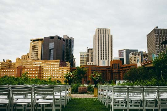 The St. Paul skyline and beautiful Raspberry Island landscaping are the backdrop for Minnesota Boat Club weddings. Photo credit to Tim & Madie Photography (http://www.timandmadie.com/)