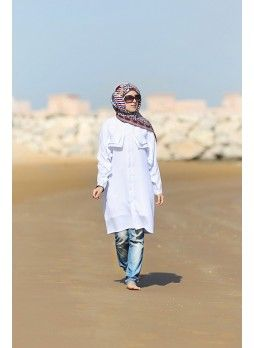 French crepe shirt with decorative ruffles starting at the chest part and continuing all the way to the sleeves. Follow the link to purchase: http://zynira.com/index.php?route=product%2Fproduct&path=65&product_id=87 #hijab #shirt #abaya #muslimfashion #scarf