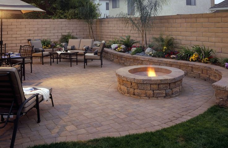 Patio with fire pit and retaining wall