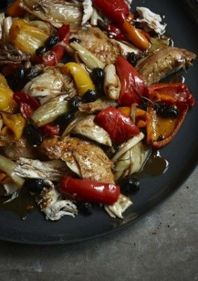 ITALIAN ROAST CHICKEN WITH PEPPERS AND OLIVES  A roast chicken always feels celebratory; indeed, a roast chicken always is celebratory. The vibrantly coloured and intensely flavoured vegetables that are cooked alongside here seem only to underline this, offering their own brightness and brio, sunny in taste as well as mood.