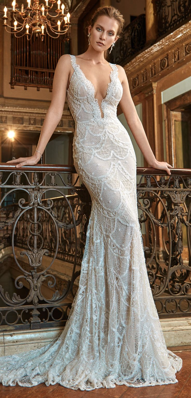 The Harper. Sexy mermaid dress with a body hugging silhouette, made of scalloped motives, hand beaded lace with a low V-neckline and hand beaded adornment all around the front and back neckline. #wedding #marriage #dress