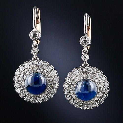 Deep royal-blue cabochon sapphires are encircled by a row of tiny twinkling rose-cut diamonds and an outer halo of sparkling European-cut diamonds in these exquisite and eminently wearable antique earrings, dating back to the the first or second decade of the twentieth century. Finely handcrafted in platinum with gold leverbacks.