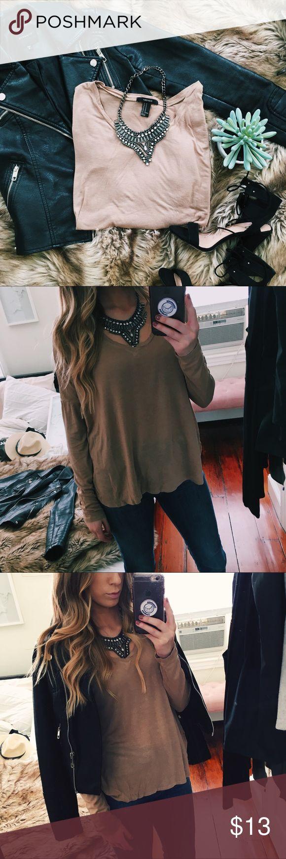 Camel colored long sleeve v neck t shirt A long sleeve camel colored t shirt. Size medium. Dropped shoulder. V neck. Excellent pre-loved condition. Forever 21 Tops Tees - Long Sleeve