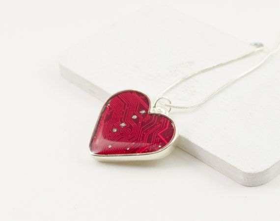I hand cut a piece of red circuit board to fit into the heart-shaped bezel. It is covered in several layers of resin which afford protection and a shiny domed coat. The pendant is 1-1/4 (30mm) tall. It is attached to the 17 silver plated snake chain, which is included. You will receive the exact necklace shown in the first three photos.  Gifting this to your geekheart? Why not pair it with a matching card- which ships free! The fourth photo shows these items together (but note that this ...