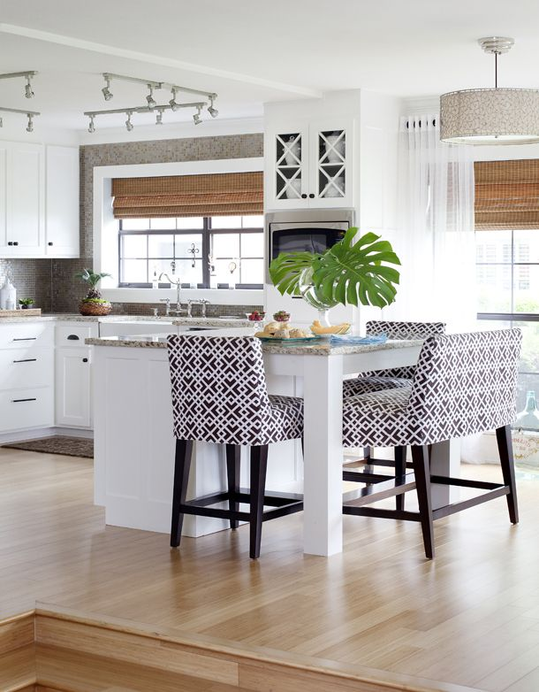 Light, bright, & pretty - nice fabric on chairs, wide window in kitchen + windows have black frames instead of white, glass doors above stove.