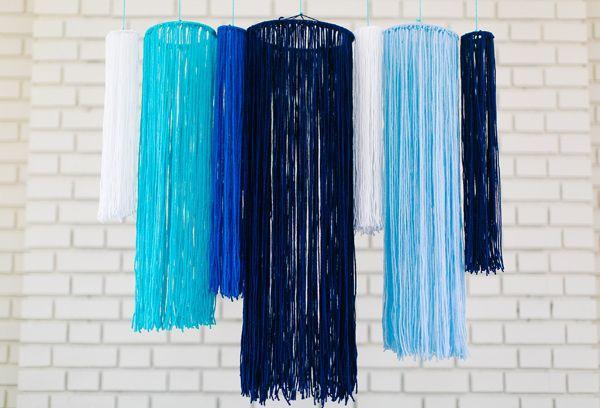 DIY Yarn Chandelier - photo by Emily Chidester - http://ruffledblog.com/diy-yarn-chandelier/