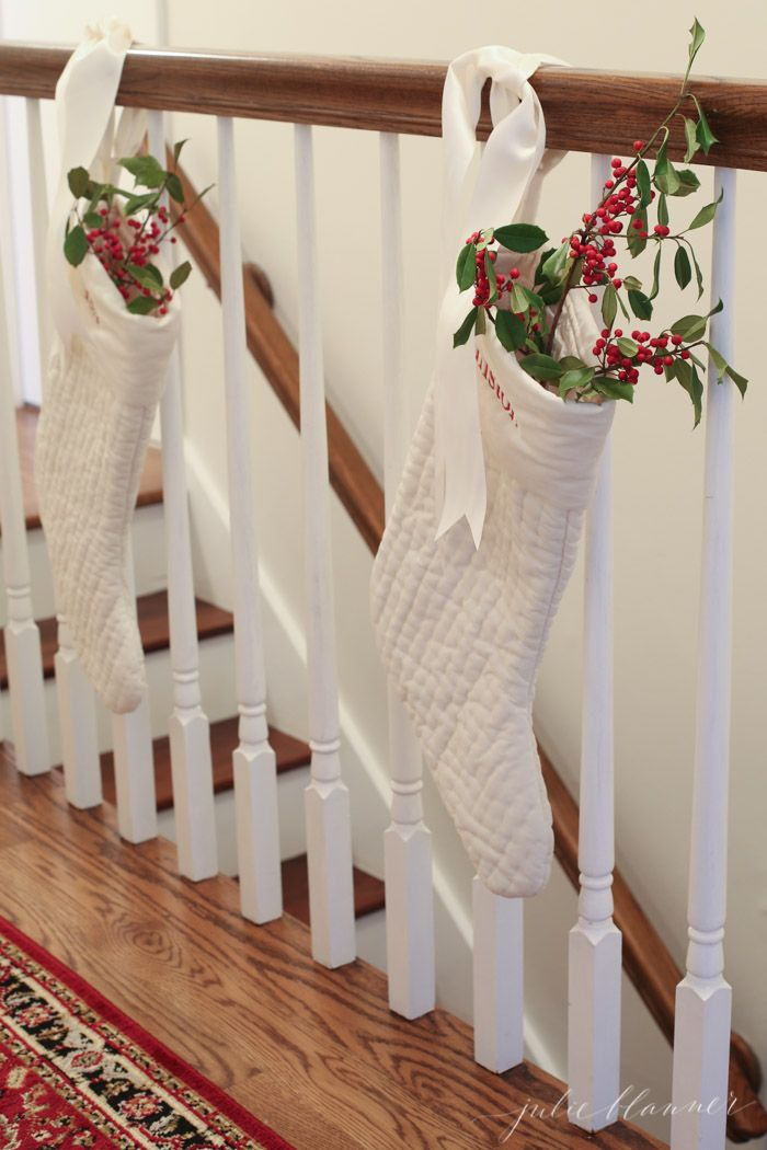 I love these white Christmas stockings filled with holly and berries! Traditional red and green Christmas decorating ideas...