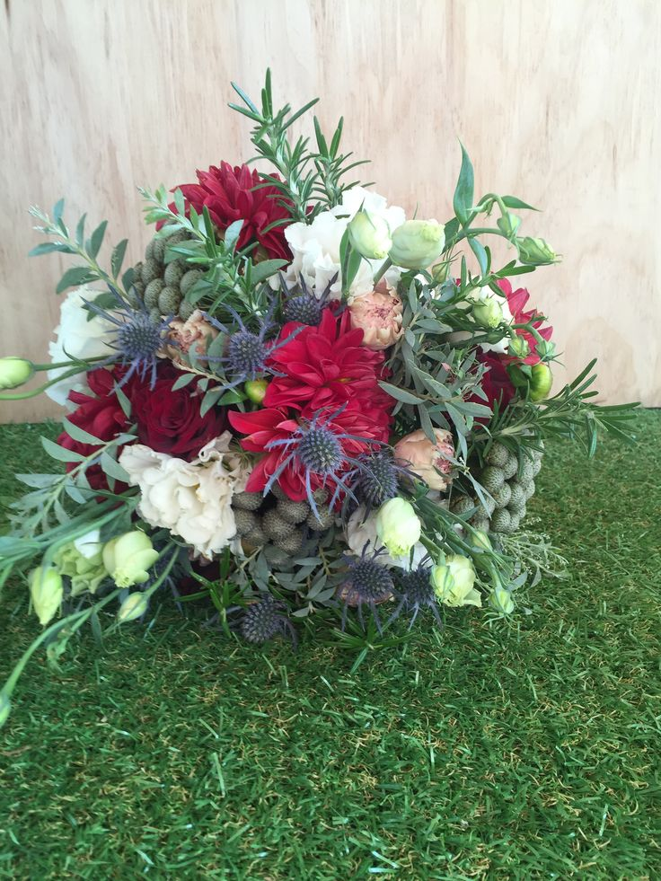 Red, white and green vintage, messy, unstructured Bridal bouquet of dahlias, rosemary, berries, lissies and other mixed flowers. Created and designed by Madison in Bloom Floral Design. www.facebook.com/madisoninbloom www.instagram.com/madisoninbloom www.madisoninbloom.com.au