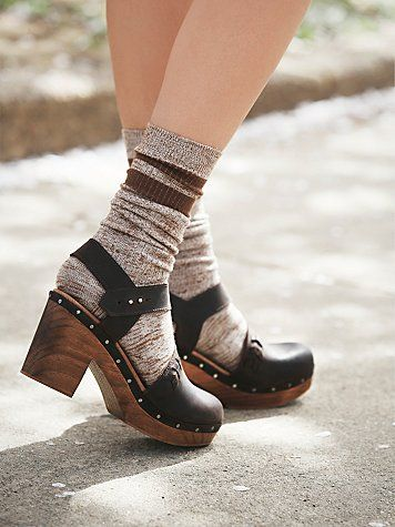 Devon Clog | Washed leather wooden heel clogs with sweet braided detail; adorable for any season. Adjustable ankle strap features easy push peg closure. Exposed metal studs. Spanish craftsmanship.  *By Free People