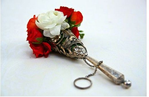Antique bouquet holder with red and white roses.jpg. This would be perfect! :)