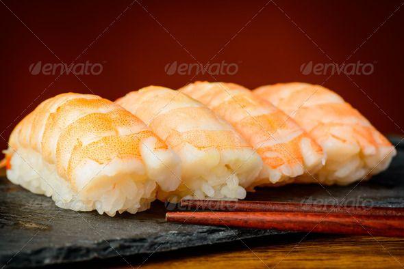 Nigiri sushi with shrimps ...  asian, chopsticks, cuisine, fish, food, futomaki, japanese, maki, meal, mixed, nigiri, plate, prawns, raw, restaurant, rice, rolls, salmon, seafood, shrimps, snack, still life, sushi, traditional, uramaki, wasabi