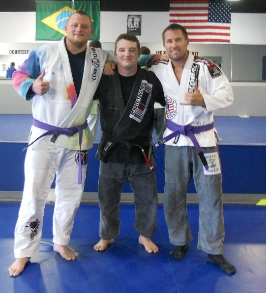 My brother (the one wearing socks) received his purple belt today