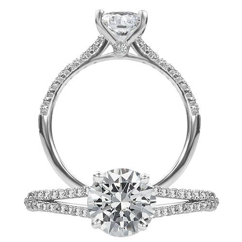 Classic diamond engagement ring featuring a prong set round cut center stone and two rows of micropavé diamonds on the split shank.