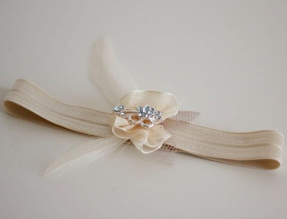 This rhinestone garter is adorned with a sparkling crystal blue rhinestones, elegant Something Blue. I created the flower using soft chiffon ribbons,