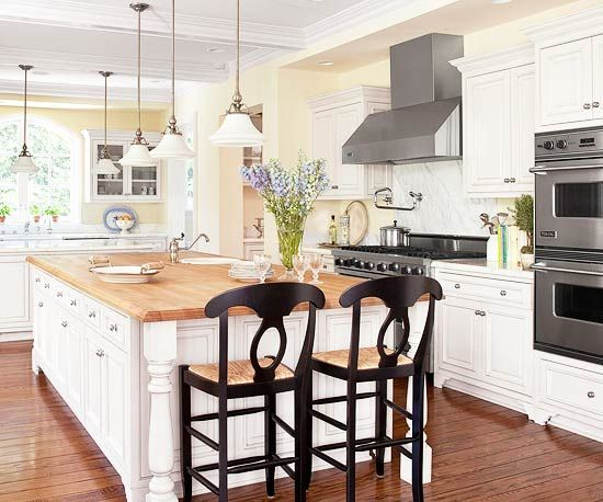 Pretty white kitchen - love the spindles under the countertop!