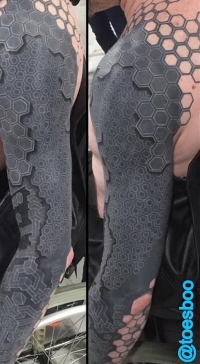 The tattoo is a series of dots arranged to resemble multiple layers of a carbon-fiber shell. It was designed by Southport, England tattoo artist Tony Booth, who runs Dabs Tattoo with his wife, Lisa.