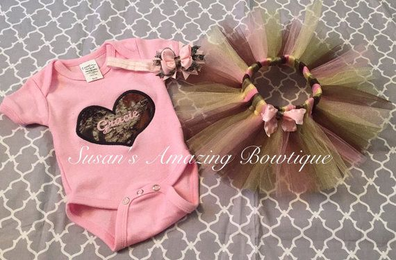 This listing is for a beautiful Camo tutu with light pink, a matching light pink onesie/shirt with Camo heart and any initials/name in the