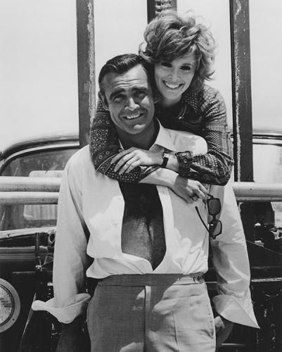 """Artist: Terry O'neill Title: Sean Connery and Jill St John, 'Diamonds Are Forever' 007  Scottish actor Sean Connery as James Bond and Jill St John during the filming of 'Diamonds Are Forever', 1971. Limited Edition Silver Gelatin Signed and Numbered  Sizes:  12"""" x 16"""" / 16"""" x 20""""  20"""" x 24"""" / 20"""" x 30""""  24"""" x 34"""" / 30"""" x 40"""" / 40"""" x 60"""" / 48"""" x 72""""  For questions or prices please contact us at info@igifa.com      IGI FINE ART"""