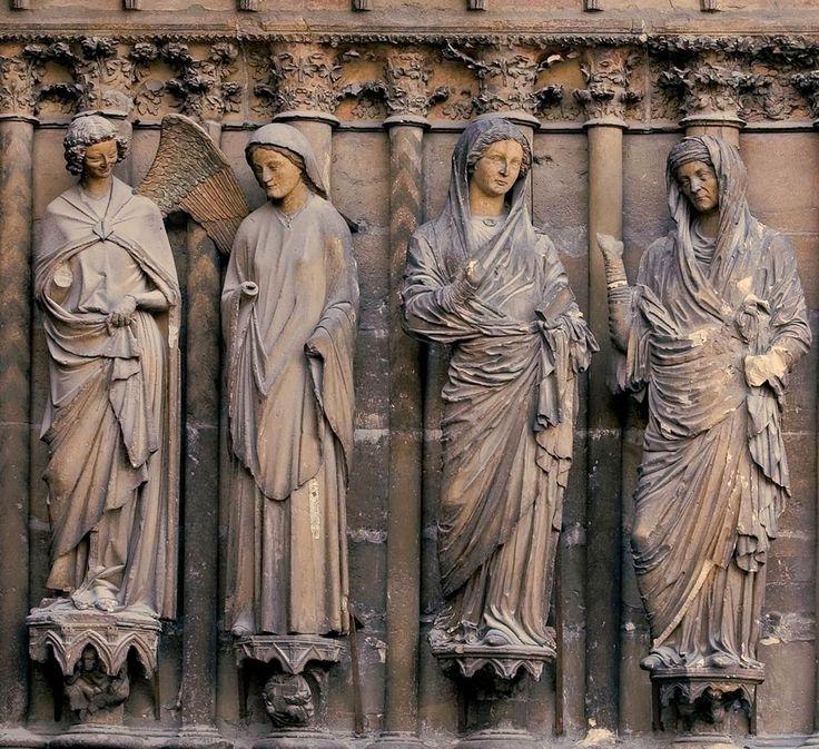 Annuciatie en Visitatie, westportaal Kathedraal Notre-Dame Reims (1230-1255): 10.4 Annuciatie: aartsengel Gabriël kondigt Maria aan  dat zij de Heilige Geest zal ontvangen en moeder zal worden van Christus.
