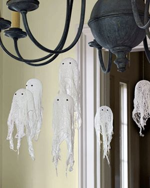 little ghosts.... maybe these could be made with torn cheesecloth draped over ping-pong balls or golf balls which would be removed after the watered-down glue dries.