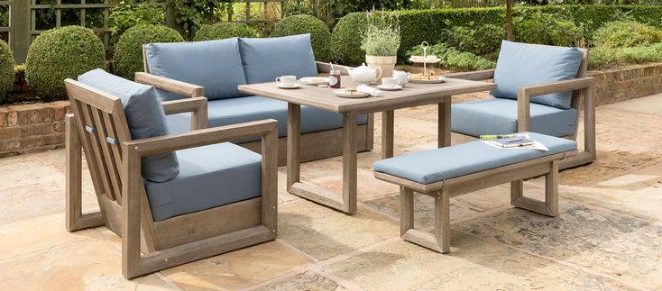 The Ezra Sofa Set creates a comfortable lounge or dining experience with the modern, outdoor/indoor style that makes our Casual Dining collection so popular. The wooden garden furniture set uses beautiful acacia and includes soft, foam core cushions.