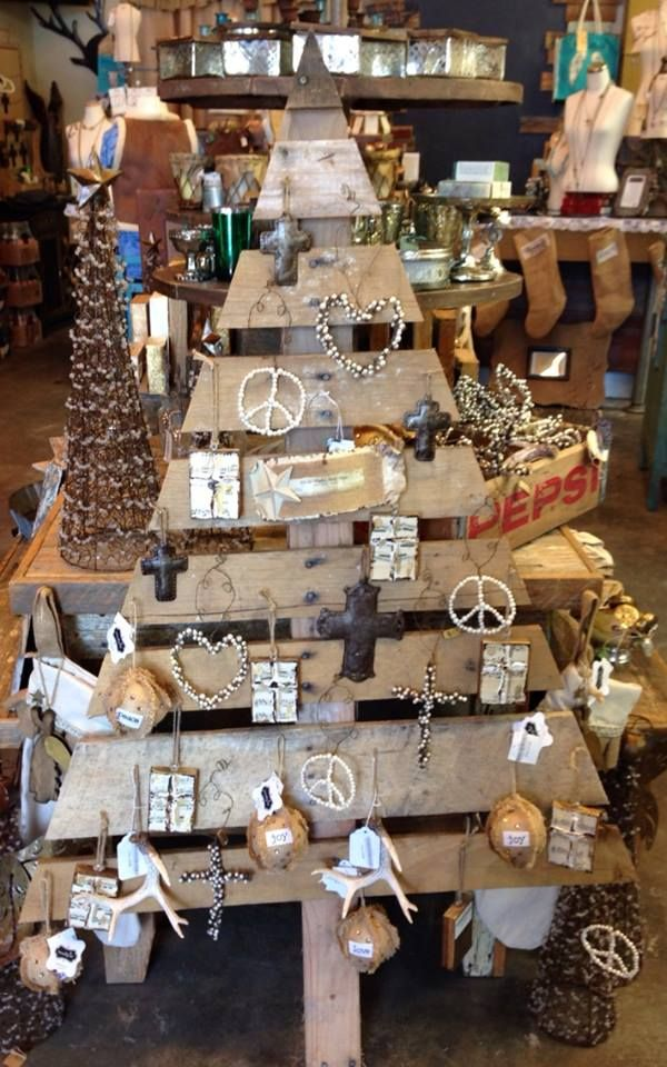 Our pallet wood Christmas tree is a perfect display for our ornaments. www.shopmerc.com